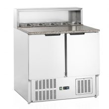 A stainless steel cabinet and a granite work surface make the GP pizza prep counter range the consummate foodservice rental option