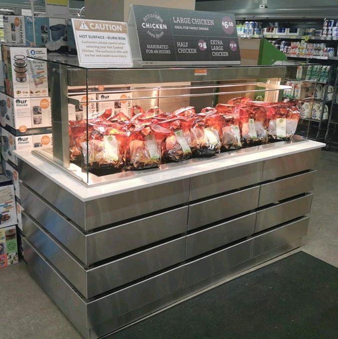 Heated Island Merchandiser in stainless steel for Rotisserie chicken display