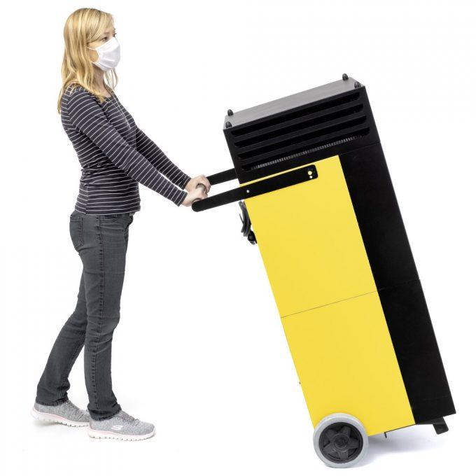 lady moving Tac V unit